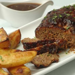 Glazed meatloaf with cheese baked potatoes and onions