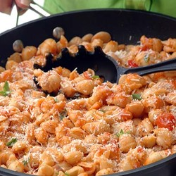 Pasta with butter beans in roast vegetable pasta sauce