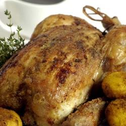 Crispy skinned roast chicken and onion gravy