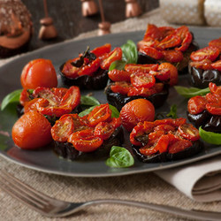 Aubergine and tomato rounds dished